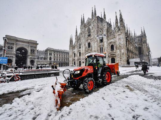 Photos: Rare snowfall blankets locked-down Milan